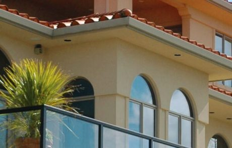 Glass railing system on Spanish style home in the Bay Area