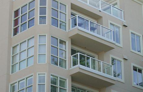 Glass railing on multifamily dwelling