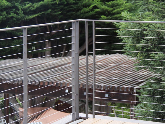 cable railing installation in Oakland, California with natural matte metal