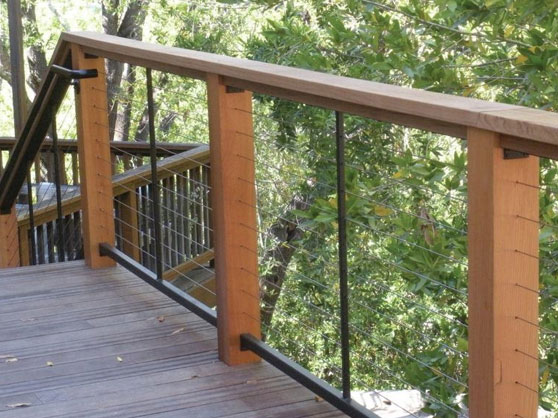 cable railing system installation with wood posts installed by our railing contractors