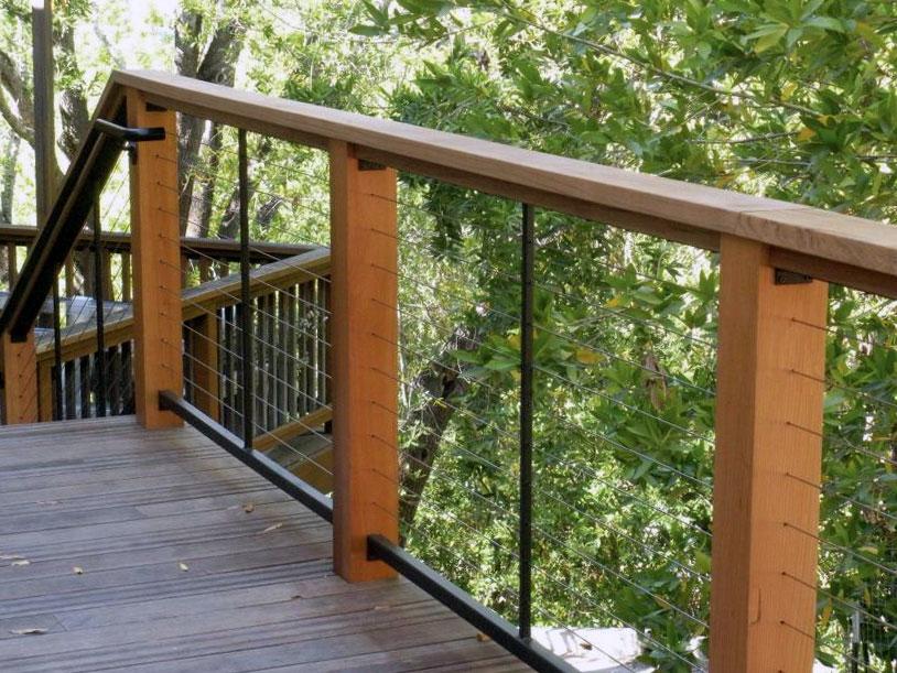 Wood cable railing incorporating matte black steel tubing