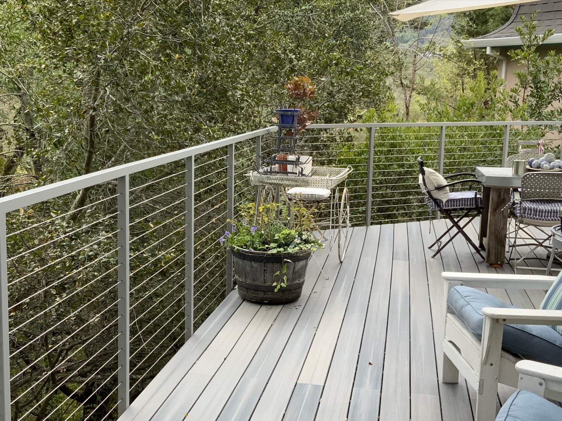 stainless steel cable railing installation on a patio deck